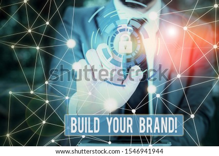 Writing note showing Build Your Brand. Business photo showcasing creates or improves customers knowledge and opinions of product Picture photo network scheme with modern smart device. #1546941944