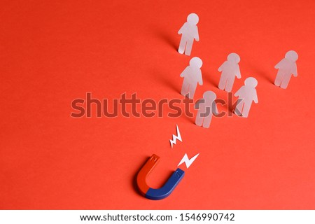 Magnet attracting paper people on red background, space for text. Business rivalry concept #1546990742