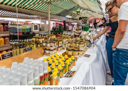 Nice France. June 12 2019. Market stall selling local products at Cours Saleya market in Nice France #1547086904