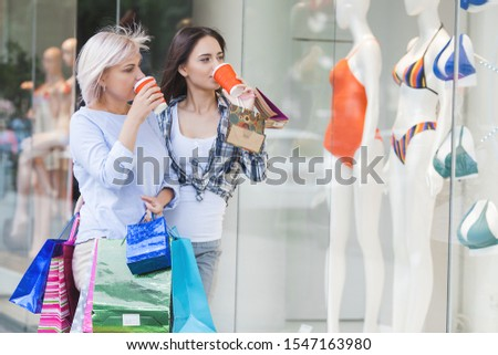 Mother and adult daughter shopping together. women with shopping bags. Family in the shopping mall. #1547163980