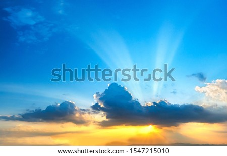 Sunset  with cloud and ray light on clouds in a blue and orange sky in twilight time #1547215010