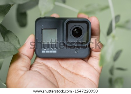 Jakarta, Indonesia - November 1, 2019: Photografer holding GoPro Hero8 Black action camera with beautiful background and bokeh. #1547220950