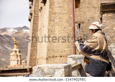 Travelers thai women people travel visit and take photo view landscape of Leh Ladakh Village from viewpoint of Leh Stok Palace at Jammu and Kashmir, India in winter season #1547402981