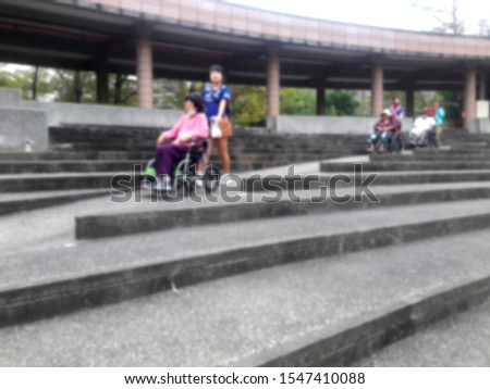 The caregiver pushed the wheelchair down the slope (deliberately shooting blur) Taiwan #1547410088