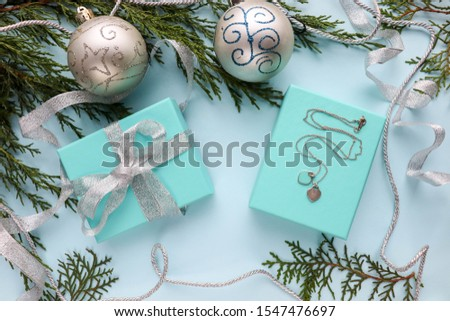 Christmas composition. fir branch, gift box, Christmas balls and Christmas decorations on a blue background. flat lay. top view #1547476697
