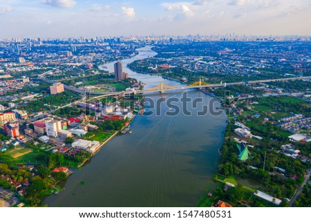 Aerial landscape of Chaopraya river with community along the river in Bangkok city, Thailand #1547480531