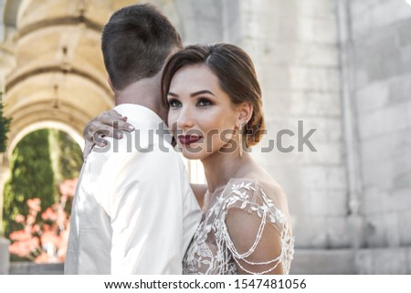 Portreit of wedding couple hugging on the romantic old city. Bride wearing elegant wedding dress  #1547481056