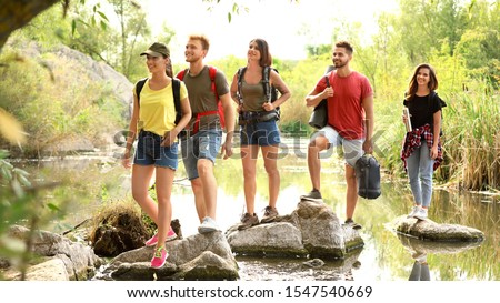 Group of friends hiking outdoors. Camping vacation #1547540669