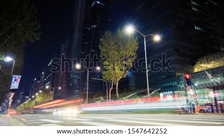 Beautiful night of Seoul road traffic, view on the busy intersection in Gangnam District. Cars, buses and other vehicles passing by creating picturesque light trails. #1547642252