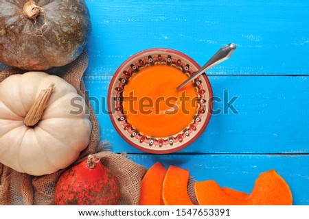 Still life with pumpking soup and pumpkins #1547653391