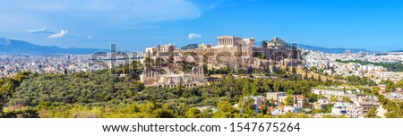 Panorama of Athens with Acropolis hill, Greece. Famous old Acropolis is a top landmark of Athens. Landscape of the Athens city with classical Greek ruins. Scenic view of remains of ancient Athens. #1547675264