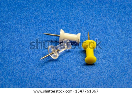 Macro push pins on the blue background #1547761367