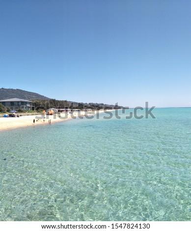 Safety Beach,  Victoria, Australia. Beautiful aqua water, white sand,  summer,  sun, people enjoying the beach, beach huts in the background. #1547824130