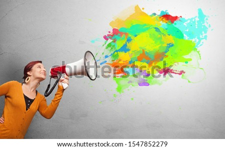Person with megaphone and colorful splashes #1547852279