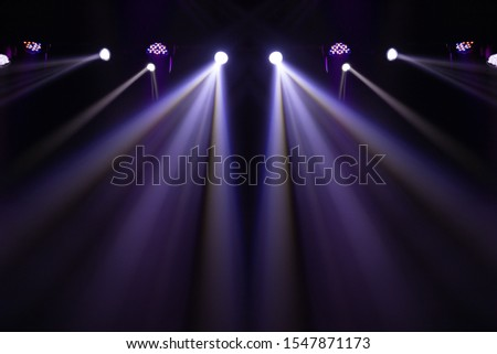 Theater lights spotlights over the stage, texture background for design. #1547871173