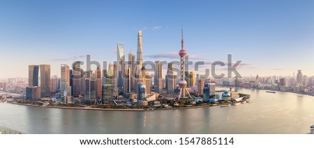 shanghai skyline panorama in sunset, pudong financial center with huangpu river, China.