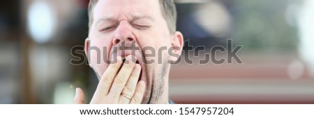 Exhausted Sleepy Male Yawning Facial Portrait. Bored Disheveled Man Closing Gape Mouth with Hand. Drowsy and Bored Person. Adult Tired Guy with Closed Eyes Want to Sleep Close-up Photography. #1547957204