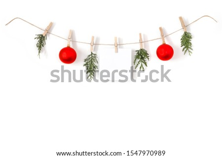 Christmas composition on a white background. Sisal string, fir twigs, Christmas balls, place for your advertisement or text. Wooden laundry clips. copy space, top view, flat photo. December day and Ch #1547970989