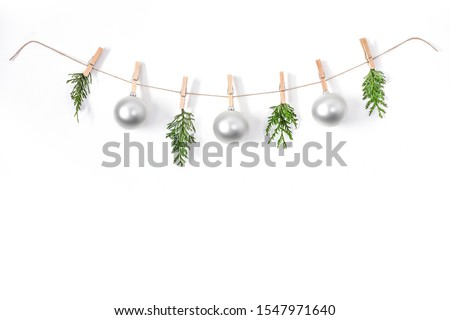 Christmas composition on a white background. Sisal string, fir twigs, Christmas balls, place for your advertisement or text. Wooden laundry clips. copy space, top view, flat photo. December day and Ch #1547971640