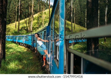 Travel by train. The girl travels by train to beautiful places. Beautiful girl traveling by train among mountains. Travel the world. Trains Sri Lanka. Railway transport. Railway. Transport Asia #1547991416