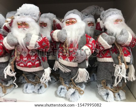 Christmas ornaments, gifts and home decorations. Santa Claus and other fairy-tale creatures are waiting for their new customers in department stores shop. A North Pole creature a long white beard #1547995082