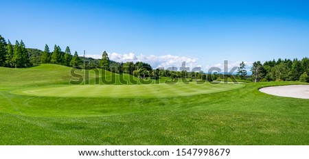 Panorama View of Golf Course with beautiful putting green. Golf course with a rich green turf beautiful scenery. Royalty-Free Stock Photo #1547998679