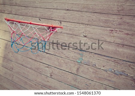 basketball hoop screwed to a wooden wall of a village house #1548061370