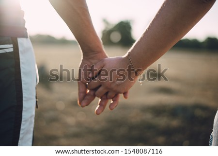 Lovers couple holding hands in a forest. Summer,spring #1548087116