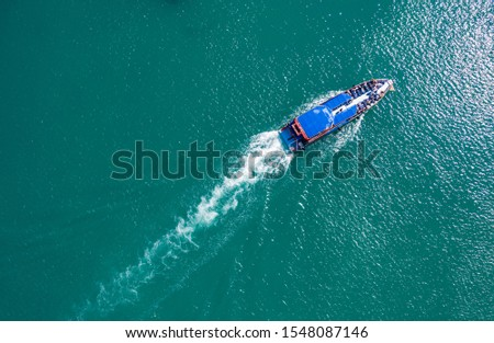 pleasure boat with tourists on Board floating in the sea, the trail with waves behind, top view from the drone #1548087146