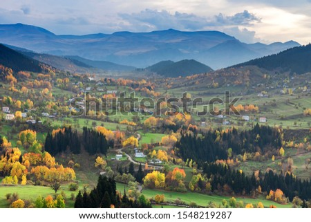 colorful trees in a village and autumn landscape #1548219287