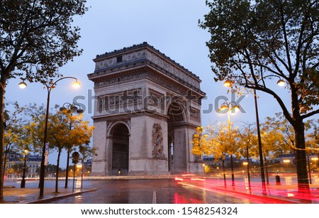 The Triumphal Arch in rainy Morning. It  is one of the most famous monuments in Paris. It honors those who fought and died for France. #1548254324