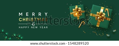 Holiday background Merry Christmas and Happy New Year. Xmas design with realistic festive objects, sparkling lights garland, green gift box, ball bauble, glitter gold confetti. Horizontal banner Royalty-Free Stock Photo #1548289520