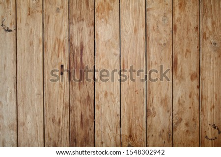 a wooden floor with a worn surface #1548302942