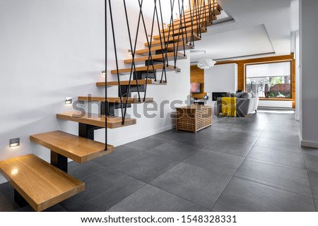 Modern interior design - stairs in wooden finishing Royalty-Free Stock Photo #1548328331
