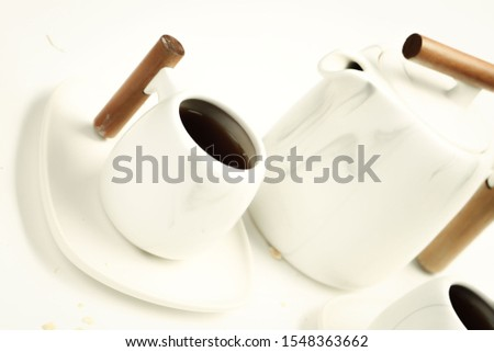 Delicious hot coffee cup on table #1548363662