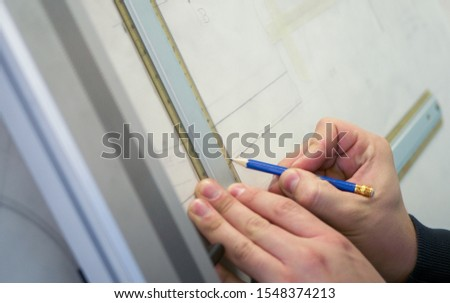 Mechanical engineer draws on the drawing board #1548374213