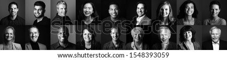 Group of beautiful beautiful people in front of a dark background Royalty-Free Stock Photo #1548393059