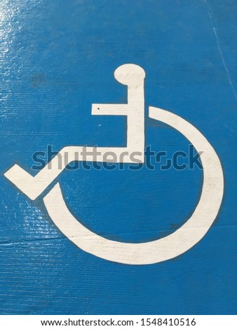 Disabled icon at the airport. special area for raising and lowering passengers with disabilities. #1548410516