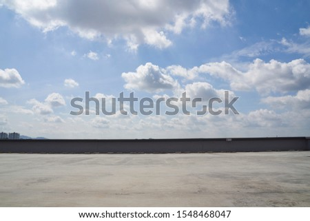 Rooftop car park with a beautiful sky #1548468047