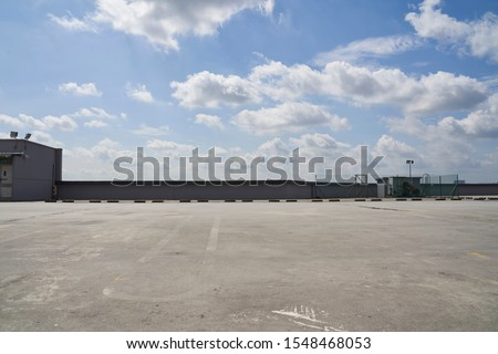 Rooftop car park with a beautiful sky #1548468053