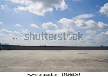 Rooftop car park with a beautiful sky #1548468068