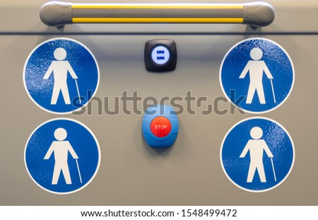 Symbol for seat or area reserved for the elderly on city buses. Symbol with white person on a blue background. Stop booking button. usb socket #1548499472