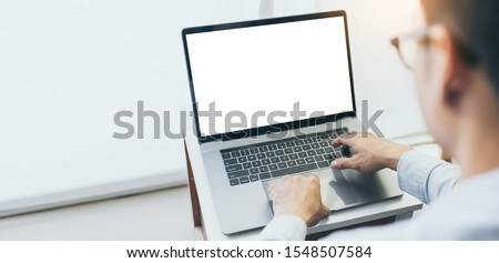 mockup image blank screen computer with white background for advertising text,hand man using laptop contact business search information on desk in office.marketing and creative design #1548507584