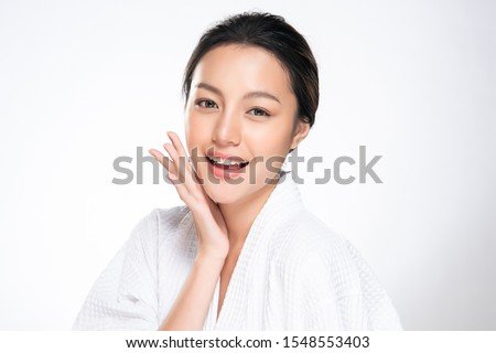 Beautiful young Asian woman touching soft cheek and smile with clean and fresh skin. Happiness and cheerful with, isolated on white background, Beauty and Cosmetics Concept, #1548553403