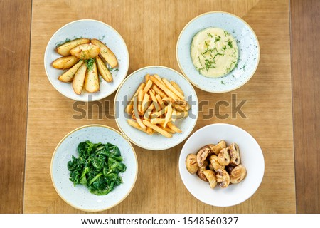 Different side dishes. Variety of dishes on the table. Restaurant menu. #1548560327