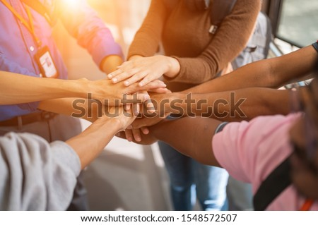 Large group of businessmen join hands for business cooperation Royalty-Free Stock Photo #1548572507