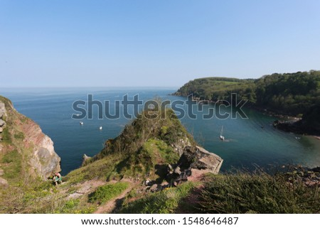 Ocean view of Anstey's Cove from the South West Coast Path of Devon in England Royalty-Free Stock Photo #1548646487