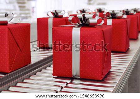 Christmas gift boxes on conveyor rollers ready to be shipped by courier for distribution #1548653990