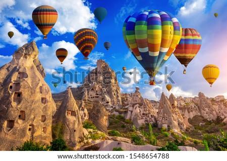 Colorful hot air balloon flying over Cappadocia, Turkey. #1548654788
