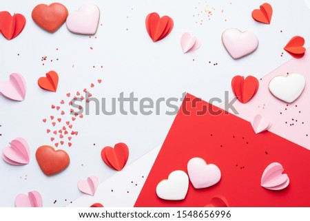 Valentines Day background with cookies, red and pink hearts on pastel background #1548656996